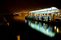 The Ferry Terminal and Bay Bridge in San Francisco, California at night