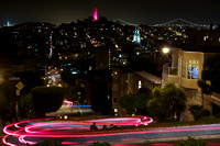 View of Coit Tower and Lombard Street in San Francisco, California at night